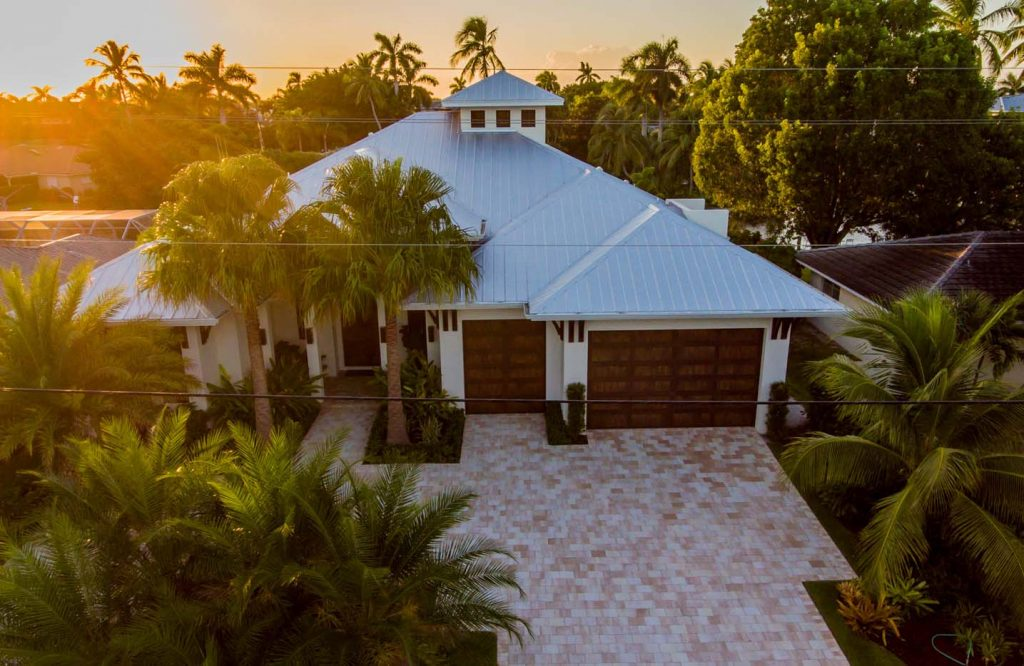 Beautiful sunset overlooking new Florida home with metal roof installed by alliance group.